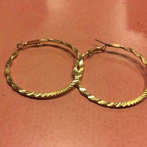 Big gold hoop earrings.